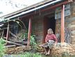 Thuli Maya, 78, sits outside her new earthquake resistant home. Makwanpur, Nepal.